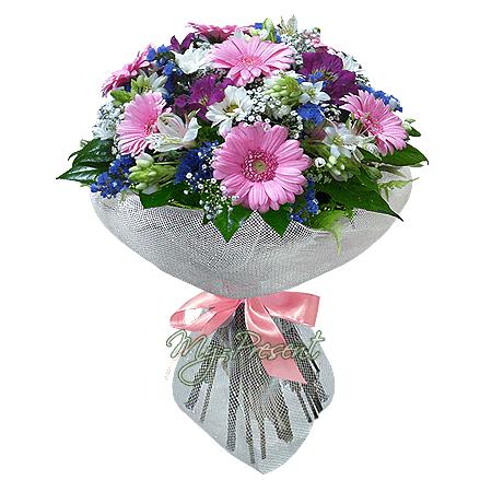 Bouquet of gerberas, alstroemerias and chrysanthemums decorated verdure