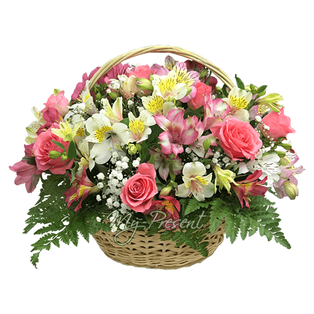 Basket with roses and alstroemerias decorated with verdure