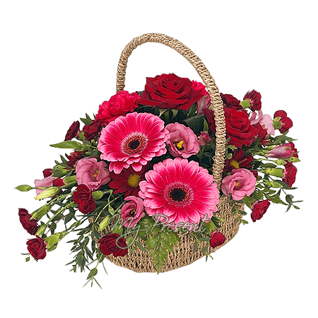 Basket with roses, gerberas, lisianthus decorated with verdure in Erevan