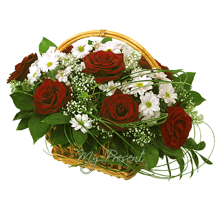 Basket with roses and chrysantemums decorated with verdure