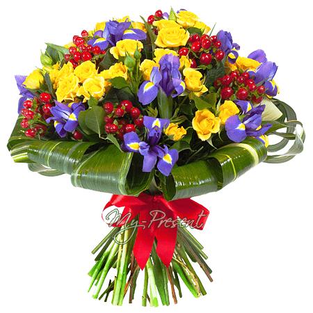 Bouquet of roses, irises and giperikum decorated verdure